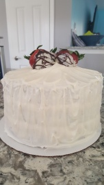 3-Layer Yellow Cake w/fresh strawberries between each luscious layer, frosted with a light dreamy cream cheese frosting