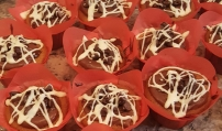 Sweet Potato Chocolate Chip Cupcake - what a delicious mess. Moist cake topped with chocolate ganache and chips then drizzled with white chocolate