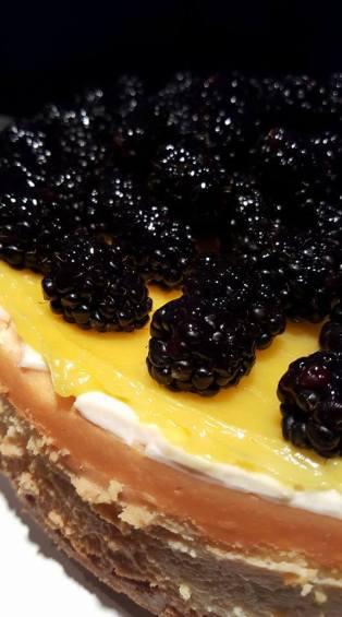 Lemon Cheesecake w/ lemon curd and fresh blackberries